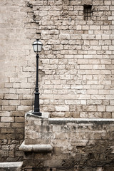 Beige contrast brick wall and lamppost