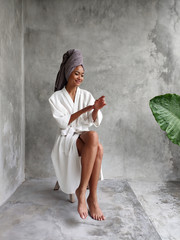 Asiatic woman with towel wrapped around her head