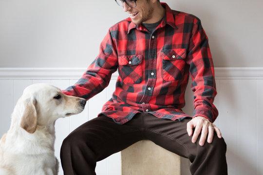 Man petting White Dog