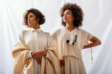 Models Wearing Cotton And Silk Vintage Dresses In The Studio