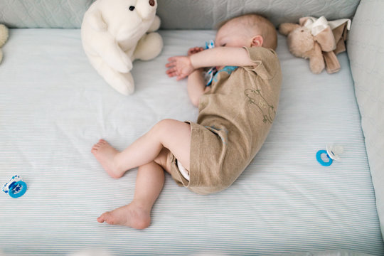 baby napping in a crib