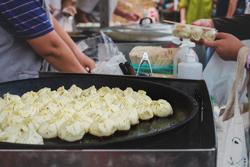 japanese food vendor frying dumplings