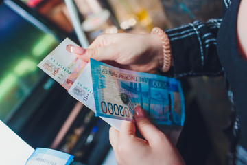 Russian rubles in the hands of a business woman.