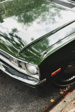 Classic green muscle car front headlight