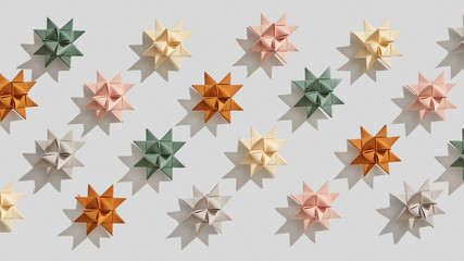 Multicolored paper origami stars presented on a gray background with shadows . Handcraft pattern. Flat lay