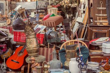 Old vintage objects and antiques for sale at the flea market Wall mural