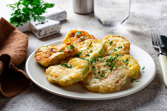 Fried zucchini slices with parsley