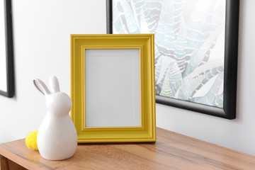 Ceramic rabbit with frame on wooden table