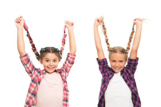 Girls long braids. Fashion trend. Fashionable cutie. Happy childhood. Keep hair braided. Sisters with long braided hair. Hairdresser salon. Having fun. Rebellious spirit. Hairstyles school style