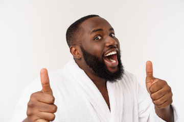 Portrait of happy afroamerican handsome bearded man laughing and showing thumb up gesture Fototapete