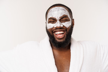 funny laughing man with mask leads healthy lifestyle, rejoicing at morning procedures. positive emotion in the morning.