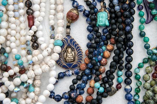 Close-up details of many yoga prayer malas.