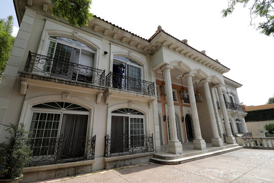 An exterior view shows the house of Chinese-Mexican businessman Zhenli Ye Gon, accused of working with drug cartels, before being auctioned by the Mexican government, during a media tour at  Lomas de Chapultepec upscale residential neighborhood