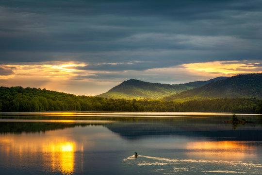 Loon watching the sunrise over Indian Lake Adirondacks New York