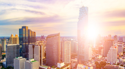 Cityscape, Bangkok Business Capital . Panoramic and Perspective View Light Sun Ray Background of Glass High Rise Building Skyscraper Commercial of Future. Business Bangkok City Background.