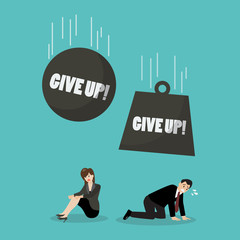 Heavy balls with word give up falling to desperate businessman and woman