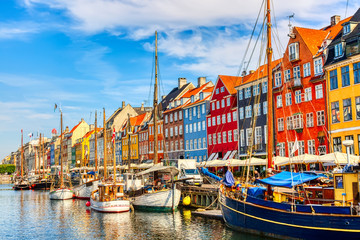 Copenhagen iconic view. Famous old Nyhavn port in the center of Copenhagen, Denmark during summer sunny day Wall mural