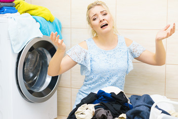 Unhappy woman having a lot of laundry