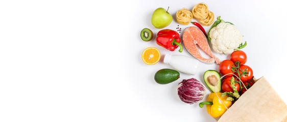 Papiers peints Nourriture Healthy food background. Healthy food in paper bag fruits, vegetables, milk, pasta and fish on white background. Shopping food supermarket concept, meal and nutrition plan. Copy space
