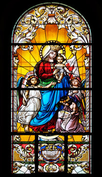 Virgin Mary with baby Jesus and Angels, stained glass window in the Saint John the Baptist church in Zagreb, Croatia