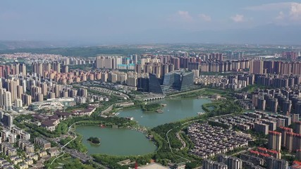 Fotomurales - aerial video of xian cityscape of qujiangchi ruins park, China