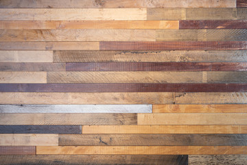 Various tone of wooden stripes use as wall partition or fence cladding in horizontal line which also use as building facade  decoration and household.