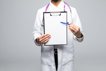 Closeup portrait of handsome indian male health care professional or doctor or nurse holding clipboard up and showing space for text, isolated on white background with copy space