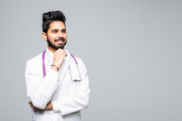 Indian male doctor hands on chin on the white background