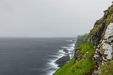 Steep coastline ultra long exposure on a misty day