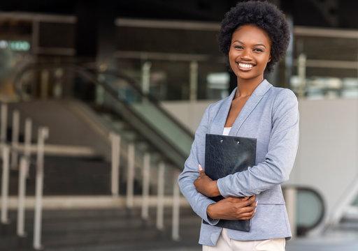 Female African American job seeker keeping a folder with CV