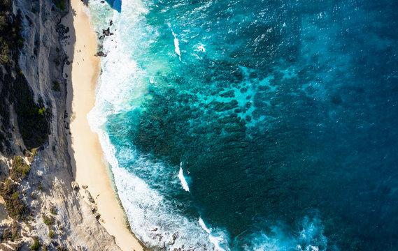 Top Down Aerial Shot Of Diamond Beach Thousand Islands at Nusa Penida, Bali - Indonesia