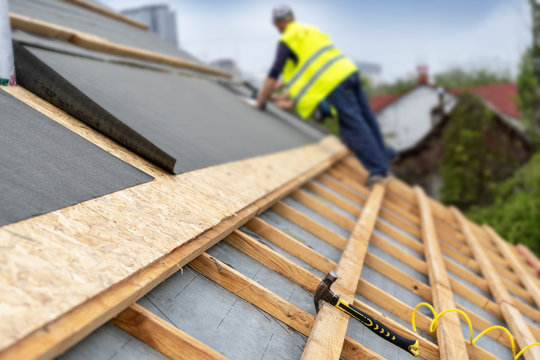 Building construction process of new wooden roof on wood frame house