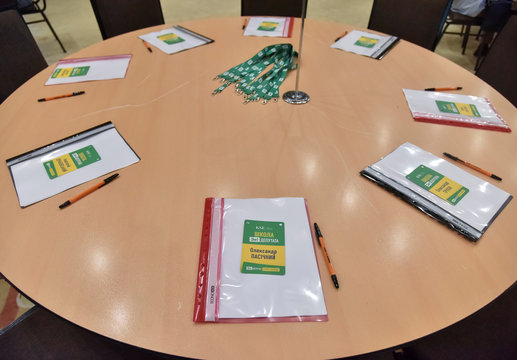 Folders for notes and ID badges are seen at a boot camp for newly elected lawmakers of Ukrainian President Volodymyr Zelensky's political party Servant of the People in Truskavets
