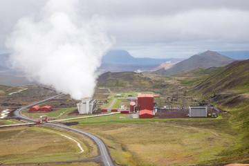 Krafla, Iceland - July 23 2019: geothermal power plant of Krafla. Geothermal area in Iceland with pipes and steaming vents