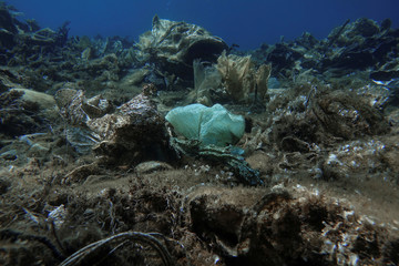 Plastic and other waste are pictured at the bottom of the sea, off the island of Andros
