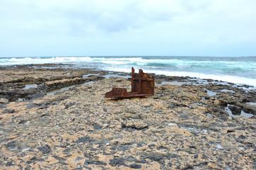 Rusty Anchor on a Volcanic Rocky Beach of Fuerteventura, Canary Islands