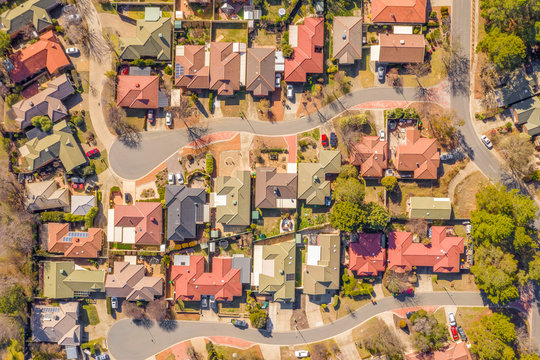 Aerial view of streets and rooftops in the suburb of Holt in Canberra, Australia