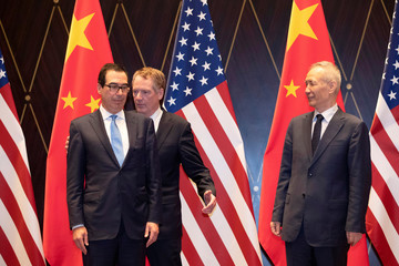 U.S. Trade Representative Robert Lighthizer, Chinese Vice Premier Liu He and U.S. Treasury Secretary Steven Mnuchin take their position for a family photo at the Xijiao Conference Center in Shanghai