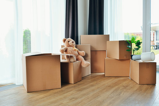Moving boxes and furniture in new home