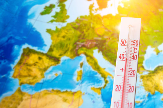 Thermometer with a high temperature of forty degrees Celsius, against the background of continent Europe. Hot weather concept.