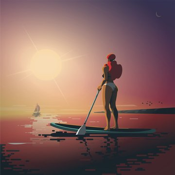 Girl on paddle board in the sunset