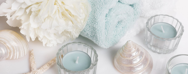Spa gentle spring or summer background banner with peony flowers and seashells, candles
