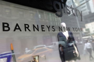 The Barneys New York sign is seen in a display window outside the luxury department store in New York
