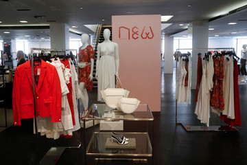 Clothes are seen on display inside the Barneys New York the luxury department store in New York