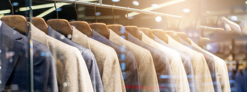 Clothes Shop Costume Dress Fashion Store Style Concept Jackets for men and hangers in a shop window