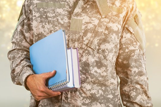 National military force man with notebooks isolated on background