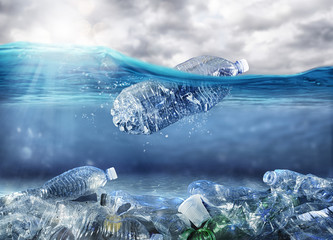Fototapeta Floating bottle. Problem of plastic pollution under the sea concept obraz