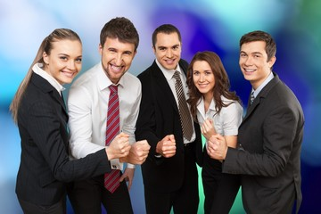 Wall Mural - Business team holding hands together, celebrating success on background