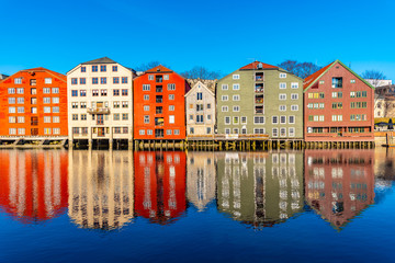Garden Poster Scandinavia Colorful timber houses surrounding river Nidelva in the Brygge district of Trondheim, Norway