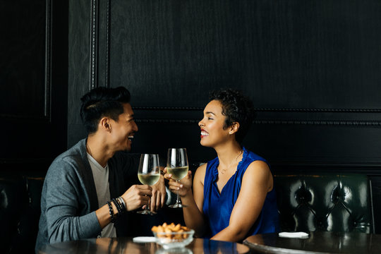 Smiling couple having drink in restaurant